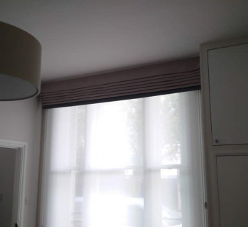 What a difference elegantly dressed windows make to this NW London flat!